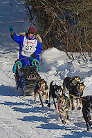 Musher Karin Hendrickson on Long Lake at the Re-Start of the 2011 Iditarod Sled Dog Race in Willow, Alaska.