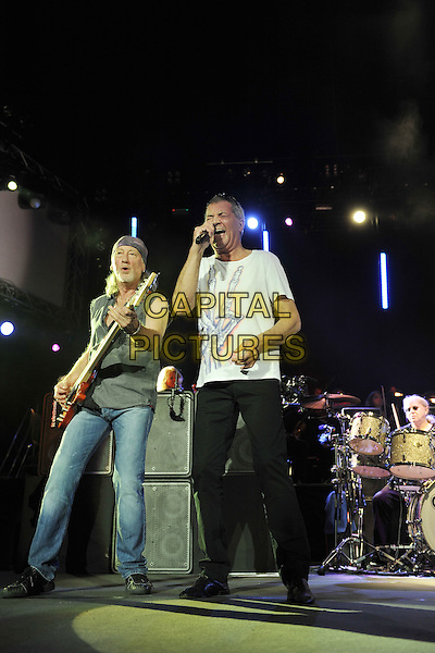 Roger Glover and Ian Gillan.Deep Purple performing live in concert, o2 Arena, Greenwich, London, England. 30th November 2011.on stage gig performance performing music full length black jeans denim white t-shirt singing guitar .CAP/MAR.© Martin Harris/Capital Pictures.