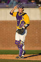 Catcher Jared Avchen #22 of the East Carolina Pirates yells instructions to the infield at Clark-LeClair Stadium on February 20, 2010 in Greenville, North Carolina.   Photo by Brian Westerholt / Four Seam Images