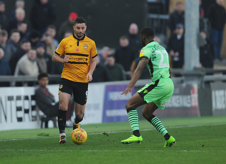 Newport County's Padraig Amond under pressure from Colchester United's Kane Vincent-Young<br /> <br /> Photographer Kevin Barnes/CameraSport<br /> <br /> The EFL Sky Bet League Two - Newport County v Colchester United - Saturday 17th November 2018 - Rodney Parade - Newport<br /> <br /> World Copyright © 2018 CameraSport. All rights reserved. 43 Linden Ave. Countesthorpe. Leicester. England. LE8 5PG - Tel: +44 (0) 116 277 4147 - admin@camerasport.com - www.camerasport.com