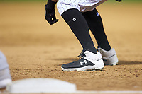 A close-up of the Under Armour cleats worn by Brandon Guyer (11) during the game against the Toledo Mud Hens at BB&T BallPark on April 23, 2019 in Charlotte, North Carolina. The Knights defeated the Mud Hens 11-9 in 10 innings. (Brian Westerholt/Four Seam Images)