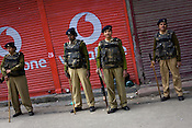 Women soldiers from the paramilitary force, Central Reserve Police Force (CRPF) are seen patrolling the streets on empty streets in the downtown area of Nowhatta, Srinagar, summer capital of Jammu and Kashmir, India. A 50 hour curfew was imposed on May 5th to boycott the elections on May 7, 2009. ..Kashmir went into polls on the 4th round of Indian general elections. About 26 percent polling was recorded in the Indian parliamentary elections held in Kashmir on Thursday, May 7th 2009. The poll percentage was on the higher side this year as compared to 2004 polls when 15.04 percent polling was recorded.