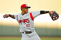 Carolina Mudcats shortstop Francisco Lindor (12) makes a throw to first base between innings of the game against the Winston-Salem Dash at BB&T Ballpark on April 13, 2013 in Winston-Salem, North Carolina.  The Dash defeated the Mudcats 4-1.  (Brian Westerholt/Four Seam Images)