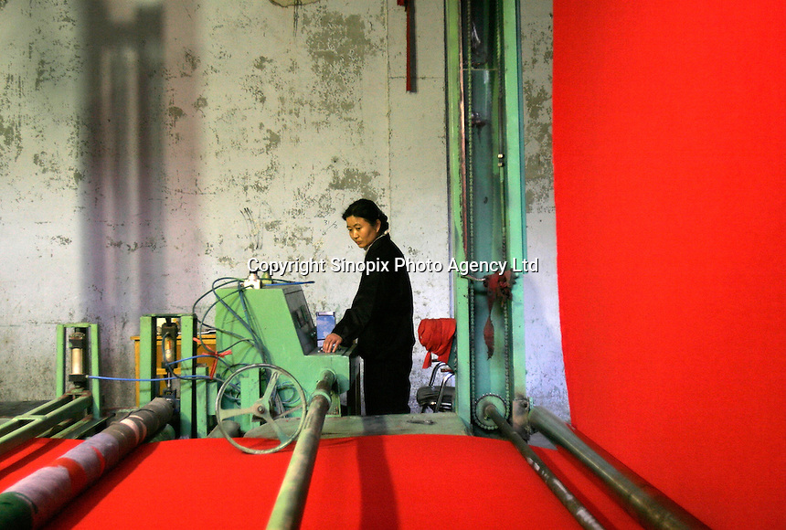 Employees work at the Golden Era Carpet Factory in Laiwu, Shandong Province, China..