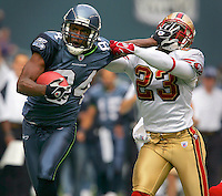 Seahawks WR Bobby Engram stiff arms 49ers CB Mike Rumph on a 60 yard pass play setting up Seahawk touchdown in the first half of the game. Alexander scored three touchdowns in the game at Qwest Field in Seattle on September 26, 2004.