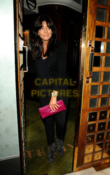 CLAUDIA WINKLEMAN .Spotted at The Ivy Restaurant, London, England..June 11th, 2008.full length black top trousers polka dot shoes pink clutch bag door .CAP/CAN.©Can Nguyen/Capital Pictures.