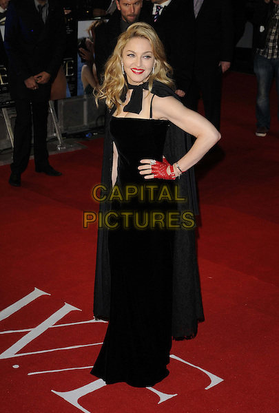 Madonna.W.E. UK film premiere at Odeon cinema, Kensington, London, England..11th January 2011.full length black lace cape sleeve hand on hip red fingerless glove dress  .CAP/CAN.©Can Nguyen/Capital Pictures.