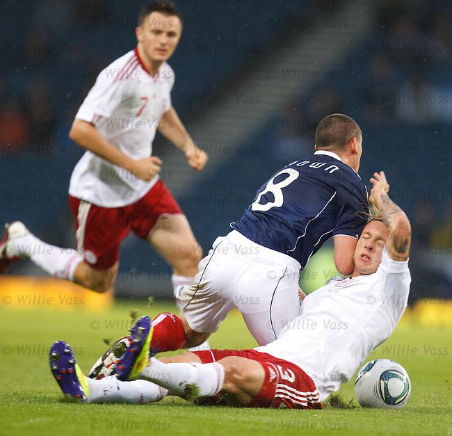 Scott Brown injured in tackle with Denmark's Simon Kjaer