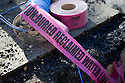 "Close-up of ""Buried Reclaimed Water Line"" caution tape to be buried with the water pipe. The cities of Palo Alto and Mountain View are jointly constructing a reclaimed water pipeline to carry recycled water from the Palo Alto Regional Water Quality Control Plant to customers along East Bayshore Parkway and Mountain View's North Bayshore area."