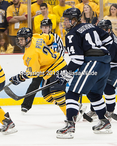 Matthew Peca (QU - 20), Ryan Obuchowski (Yale - 14) - The Yale University Bulldogs defeated the Quinnipiac University Bobcats 4-0 in the 2013 Frozen Four final to win the national championship on Saturday, April 13, 2013, at the Consol Energy Center in Pittsburgh, Pennsylvania.