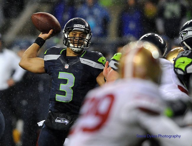 SEATTLE, WA. - DECEMBER 23: Quarterback Russell Wilson #3 of the Seattle Seahawks passes the ball during the fourth quarter of the game against the San Francisco 49ers at CenturyLink Field on December 23, 2012 in Seattle,Wa. The Seahawks won the game 42-13. (Photo by Steve Dykes/Getty Images) *** Local Caption *** Russell Wilson