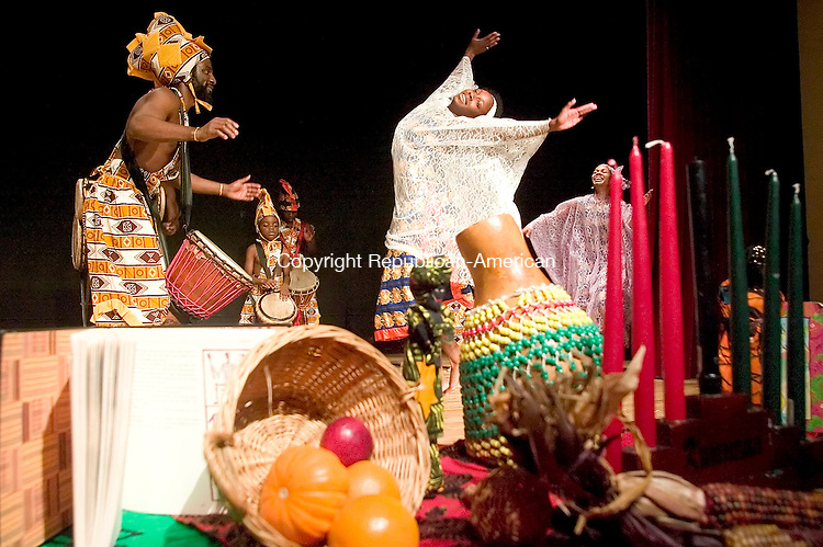 WATERBURY, CT- 30 DEC 06- 123006JT07- <br /> Kojo Bey and Oni Brown of Sounds of Afrika perform during a Kwanzaa celebration at Mattatuck Museum in Waterbury on Saturday afternoon.<br /> Josalee Thrift Republican-American