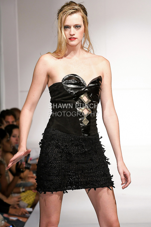 Model walks the runway in an outfit by Jorge Afanador, for the AFANDOR Spring 2011 fashion show, during Nolcha Fashion Week, September 13, 2010.