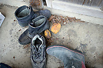 Shoes and lemons lie at the entrance of a home after residents were forced to suddenly evacuate their homes after the nuclear explosion in Minami-Soma, Fukushima Prefecture, Japan on 30 March, 2011. Many people have yet to return to their homes .  Photographer: Robert Gilhooly
