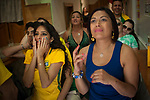 Brazilian football fans watch their national team's Russia 2018 World Cup Group E match against Costa Rica in a bar. Irun (Basque Country). June 22, 2018. (Gari Garaialde / BostokPhoto)