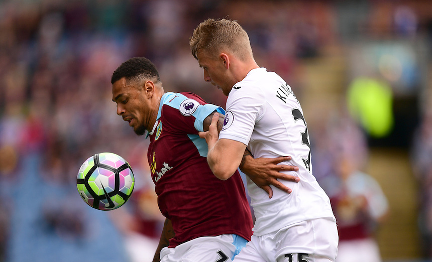 Burnley's Andre Gray shields the ball from Swansea City's Stephen Kingsley<br /> <br /> Photographer Chris Vaughan/CameraSport<br /> <br /> Football - The Premier League - Burnley v Swansea City - Saturday 13th August 2016 - Turf Moor - Burnley<br /> <br /> World Copyright &copy; 2016 CameraSport. All rights reserved. 43 Linden Ave. Countesthorpe. Leicester. England. LE8 5PG - Tel: +44 (0) 116 277 4147 - admin@camerasport.com - www.camerasport.com