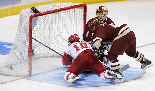 Badger Junior forward Robbie Earl scores the first of two goals against Boston College sophomore goalie Cory Schneider.  The game would end with a Wisconsin victory of 2-1.