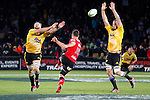 NELSON, NEW ZEALAND - MAY 29:   Dan Carter of the Crusaders clears as Jeremy Thrush and James Broadhurst of the Hurricanes attempt the charge down during the Round 16 Super Rugby match between the Crusaders and the Hurricanes at Trafalgar Park on May 29, 2015 in Nelson, New Zealand. (Photo by Marc Palmano/Shuttersport Limited)