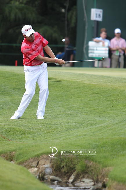 May 8,2011 - Brian Davis chips up from near the creek on 18.  Lucas Glover wins the tournament in sudden death over Jonathan Byrd at Quail Hollow Country Club,Charlotte,NC.