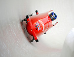 15 December 2007: Great Britain 2 pilot Jackie Davies, with Kelly Thomas on the brakes, exit turn 19 during their first run of the FIBT World Cup Bobsled Competition at the Olympic Sports Complex on Mount Van Hoevenberg, at Lake Placid, New York, USA. ..Mandatory Photo Credit: Ed Wolfstein Photo