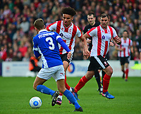 Lincoln City's Lee Angol runs at Macclesfield Town's David Fitzpatrick<br /> <br /> Photographer Andrew Vaughan/CameraSport<br /> <br /> Vanarama National League - Lincoln City v Macclesfield Town - Saturday 22nd April 2017 - Sincil Bank - Lincoln<br /> <br /> World Copyright &copy; 2017 CameraSport. All rights reserved. 43 Linden Ave. Countesthorpe. Leicester. England. LE8 5PG - Tel: +44 (0) 116 277 4147 - admin@camerasport.com - www.camerasport.com