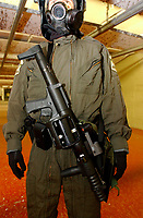 2001 File Photo, Montreal, Quebec, Canada; <br /> <br /> A Quebec provincial police (Surete du Quebec) officer<br /> in full riot gear  demonstrate an ARWIN grenade launcher at the Police firing range in Montreal<br /> <br /> (Mandatory Credit: Photo by Sevy - Images Distribution (©) Copyright 2002 by Sevy<br /> <br /> NOTE :  D-1 H original JPEG, saved as Adobe 1998 RGB.<br />  Uncompressed and uncropped original  size file available on request.