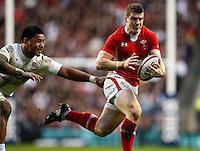Photo: Richard Lane/Richard Lane Photography. England v Wales. 25/02/2012. Wales' Scott Williams is tackled by England's Manu Tuilagi.
