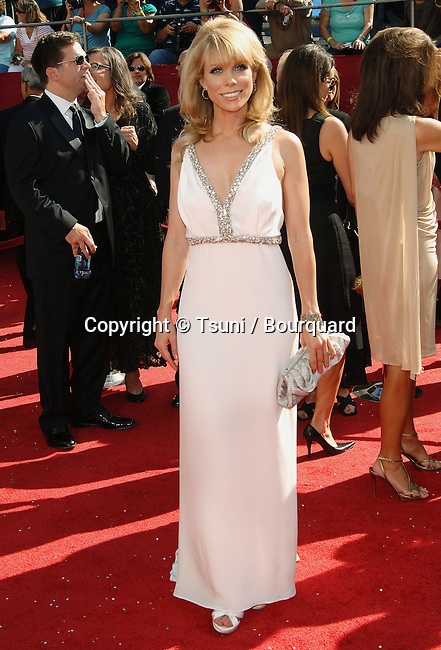 Cheryl Hines    - <br /> 60th Annual Emmys Awards at the Nokia Theatre in Los Angeles<br /> <br /> full length<br /> eye contact<br /> smile
