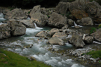 Fast flowing river tumbling over boulders on the Spanish/ French Pyrenees,Aragon, Spain.