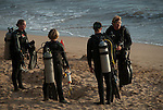 Dive guide doing dive brief before shore dive at ulua beach maui hawaii.