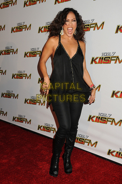 Carrie Ann Inaba.The 102.7 KIIS FM Jingle Ball 2011 arrivals held at The Nokia Theater Live in Los Angeles, California, USA, December 3rd 2011..full length black dress tights trousers boots clutch bag mouth open funny.CAP/ADM/BP.©Byron Purvis/AdMedia/Capital Pictures.
