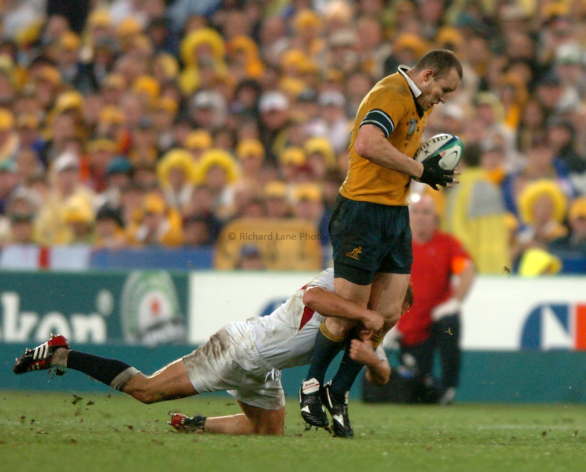 Photo: Richard Lane..Australia v England. Rugby World Cup Final, at the Telstra Stadium, Sydney. RWC 2003. 22/11/2003. .Stirling Mortlock is halted by Jonny Wilkinson.