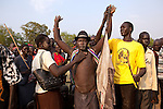 Sunday 5 december 2010 - Juba, Southern Sudan - A Dinka wrestler after winning a match. Traditional wrestling matches in Juba Stadium between Dinka wrestlers from Yirol East of Lake State and Mundari wrestlers from Terekeka County of Central Equatoria State. The matches attracted large numbers of spectators who sang, played drums and danced in support of their favorite wrestlers. The match organizers hoped that the sport would bring together South Sudan's many different tribes. Photo credit: Benedicte Desrus