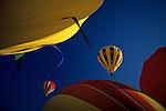 Walla Walla balloon festival hot air ballons beginning to lift off at at sunrise  Walla Walla Eastern Washington State USA..