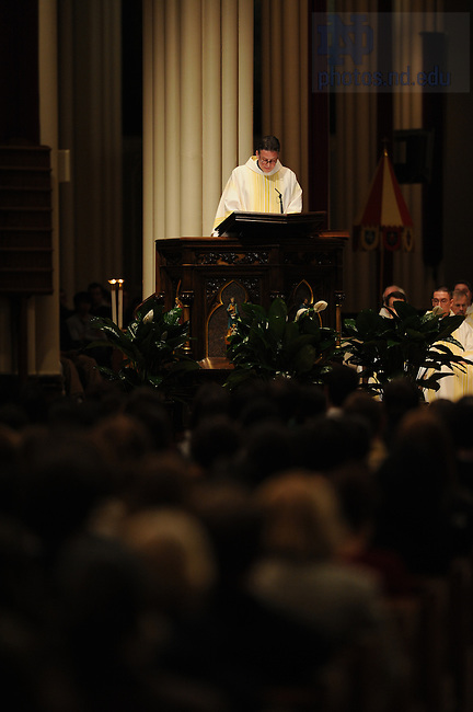 Fr. Tom Coughlin speaks at the memorial Mass for Connor McGrath and Tim Aher