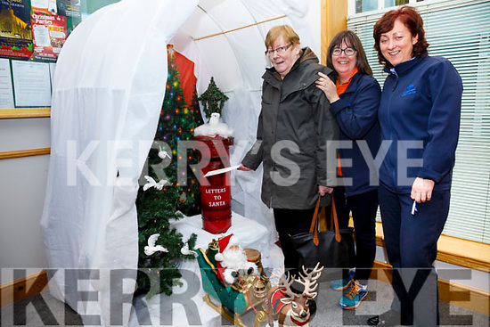 Peggy O'Leary from Tullig uses Cahersiveen Credit Unions 'Direct Line' to Santa for her Christmas Wishes, pictured here with l-r; Elma Shine(Manager CCU) & Sheila Coffey.