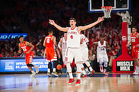 NEW YORK, NY - Sunday December 13, 2015: Federico Mussini (#4) of St. John's celebrates a big basket against Syracuse as the two square off during the NCAA men's basketball regular season at Madison Square Garden in New York City.