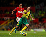 Grant Hanley of Norwich City cuts out Anthony Martial of Manchester United during the Premier League match at Old Trafford, Manchester. Picture date: 11th January 2020. Picture credit should read: James Wilson/Sportimage