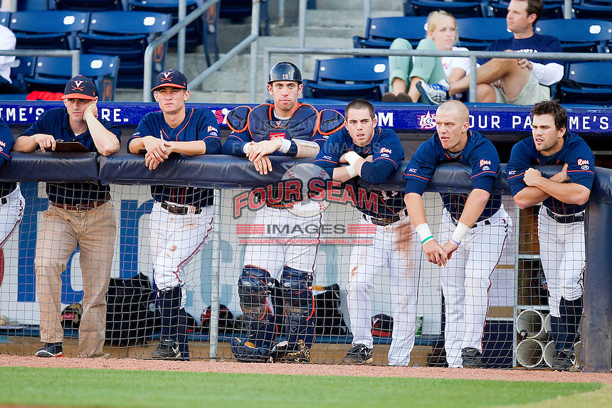 The Virginia Cavaliers bench looks on during the Atlantic Coast Conference game against the Duke Blue Devils at Durham Bulls Athletic Park on April 20, 2012 in Durham, North Carolina.  The Blue Devils defeated the Cavaliers 6-3.  (Brian Westerholt/Four Seam Images)