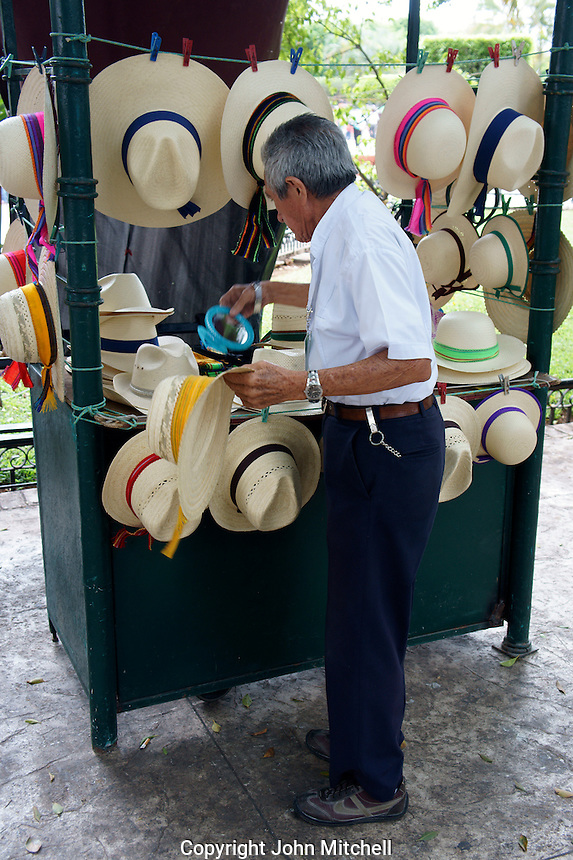 Straw jipijapa straw hat vendor at the Sunday handicrafts market in the main square, Merida, Yucatan, Mexico...