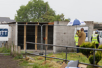 Pictured: The garage where the Banksy was painted after having it moved. Wednesday 29 May 2019<br /> Re: Contractors are working to move Banksy's Season Greeting, now owned by John Brandler, which appeared on a garage wall in Port Talbot, to a new location in the same town in south Wales, UK.