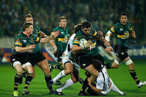 James Downey (green) breaks the tackle of Cameron McIntyre (white). 08.10.2010 Rugby Union Heineken Cup from Franklin's Gardens Northampton Saints v Castres.  Final score : Northampton 18-14 Castres