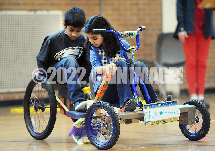 SODYSSEY28P<br /> From left, Thomas Cherian and Heeya Jagirdar of Afton Elementary School ride on a tricycle the demonstrations their solution to No-Cycle Recycle during the Southeast Pennsylvania Odyssey of the Mind tournament Saturday February 27, 2016 at Pennsbury High School West in Fairless Hills, Pennsylvania. (William Thomas Cain/For The Inquirer)