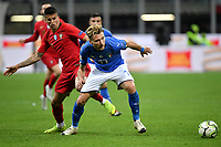 Ciro Immobile of Italy and Joao Cancelo of Portugal compete for the ball during the Nations League League A group 3 football match between Italy and Portugal at stadio Giuseppe Meazza, Milano, November, 17, 2018 <br /> Foto Andrea Staccioli / Insidefoto