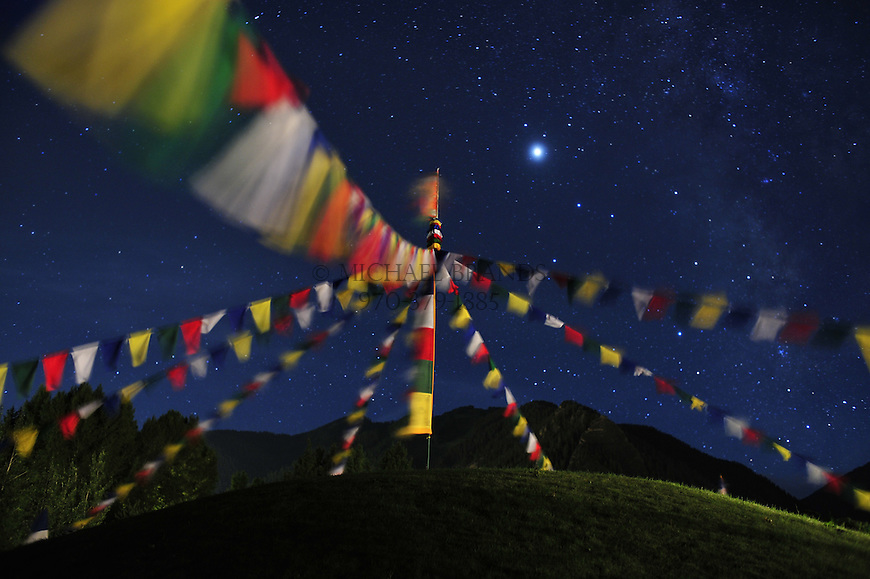 Stars shine above Tibetan prayer flags at the Aspen Institute campus in Aspen, CO. © Michael Brands, 2008