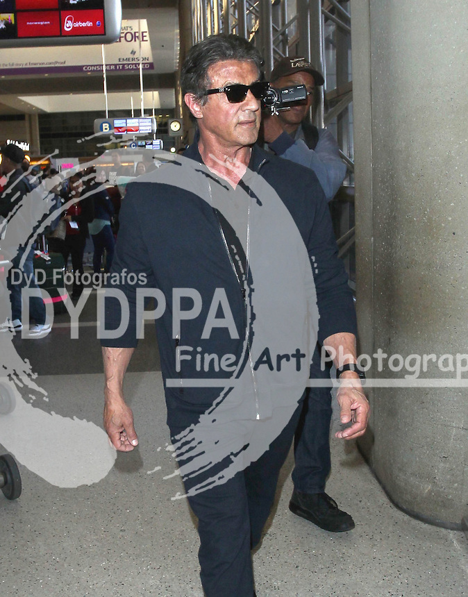 Hollywood actor Sylvester Stallone Sighted Arriving at LAX  Los Angeles International Airport LA<br /> This pic:Sylvester Stallone<br /> JOB REF: 18196 PHZ/STPR    DATE:13.05.2015