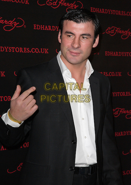 JOE CALZAGHE .Attends the Ed Hardy Store Launch Party at Westfield Shopping Centre, London, England, UK, .December 1st 2009..half length black suit hand white shirt gold bracelet .CAP/JIL.©Jill Mayhew/Capital Pictures
