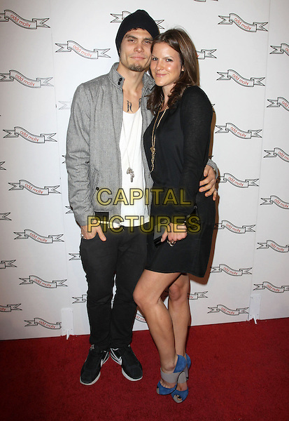 RAY BRADY & KATE SUMNER .Odd Molly Flagship Store Opening held At Odd Molly Boutique, Beverly Hills, California, USA, 19th March 2010..full length back jacket grey gray dress couple trainers blue shoes clutch bag hat peep toe .CAP/ADM/KB.©Kevan Brooks/AdMedia/Capital Pictures.