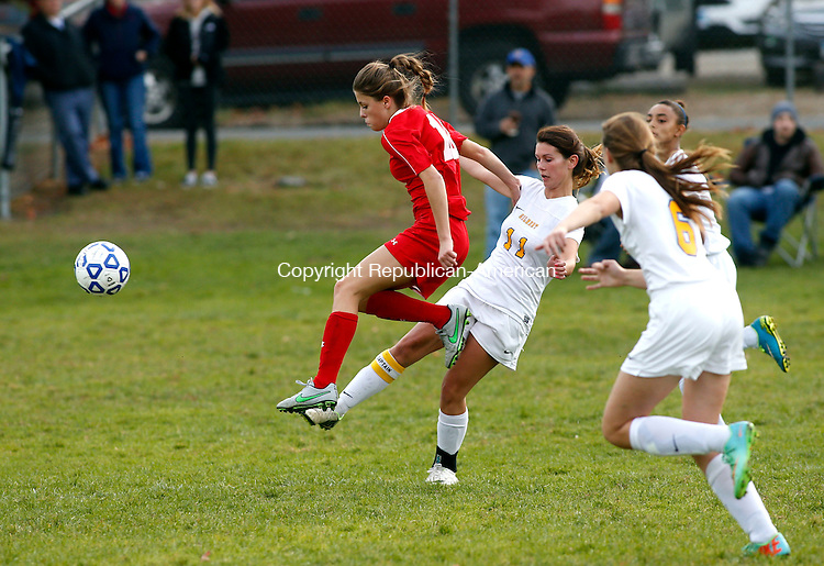 Winsted, CT- 27 October 2015-102715CM08- Wamogo's Brooke Neller, left, tires to move the ball up field as Gilbert's Jaden Arcelaschi collides with her during their soccer matchup in Winsted on Tuesday.     Christopher Massa Republican-American