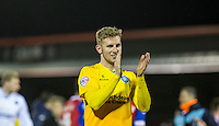 Jason McCarthy of Wycombe Wanderers applauds the support during the Sky Bet League 2 match between Dagenham and Redbridge and Wycombe Wanderers at the London Borough of Barking and Dagenham Stadium, London, England on 9 February 2016. Photo by Andy Rowland.